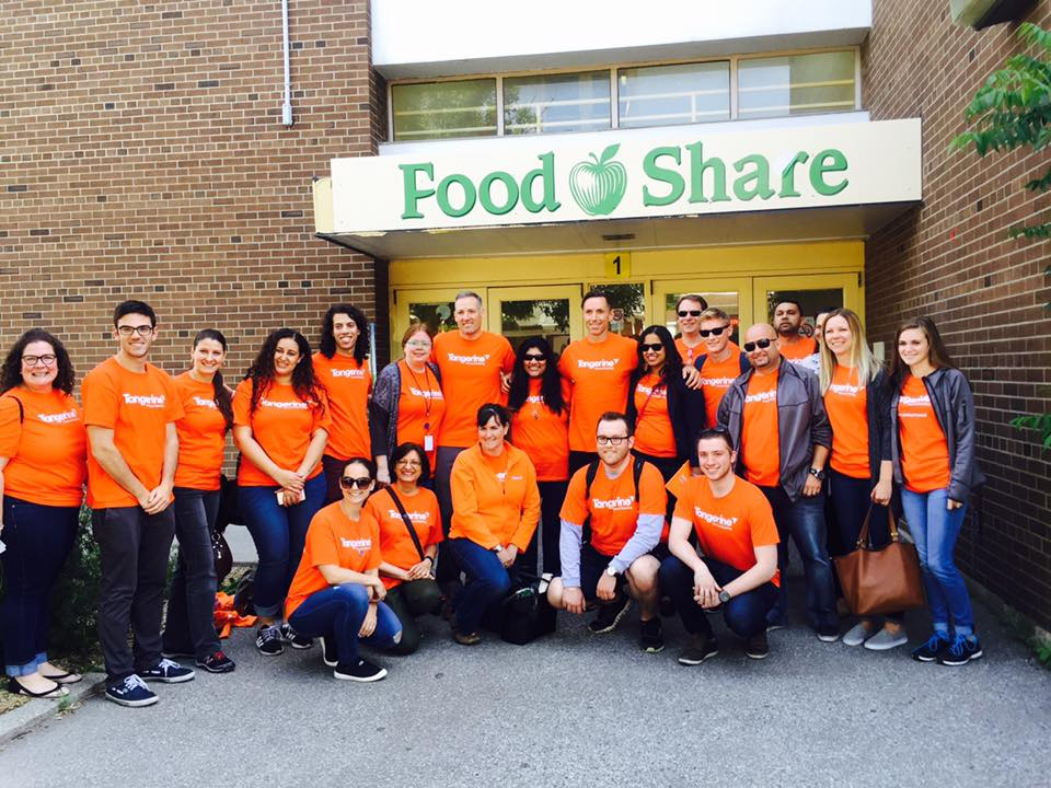 Peter Aceto and Steve Nash volunteering at food share